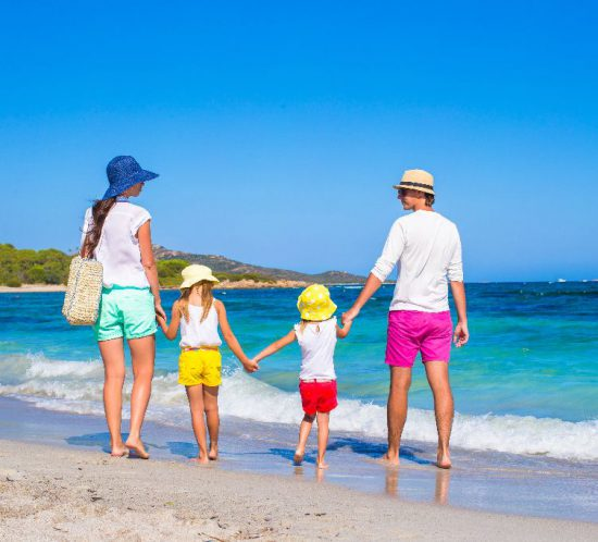 Happy-family-of-four-during-beach